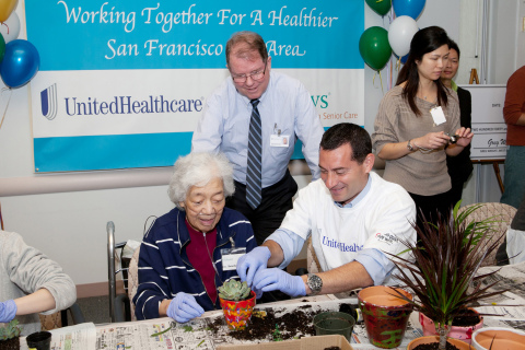 Greg Wright, West Region president, UnitedHealthcare Medicare & Retirement (right), helps Benedyne Kim, On Lok Lifeways participant (left), pot a plant while Bob Edmondson, CEO of On Lok (center), looks on at the nonprofit's Spring Volunteer Day with San Francisco Bay Area UnitedHealthcare employees Monday, April 8. The activities were capped off with UnitedHealthcare presenting On Lok an $897,000 grant to strengthen its services to seniors in the region (Photo: Amy Sullivan).