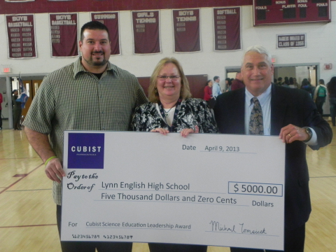 Former New England Patriot Joe Andruzzi (left) and Cubist Chief Scientific Officer Steve Gilman recognize Lauren Mezzetti of Lynn English High School, as the recipient of the Cubist Science Education Leadership Award (Photo: Business Wire)