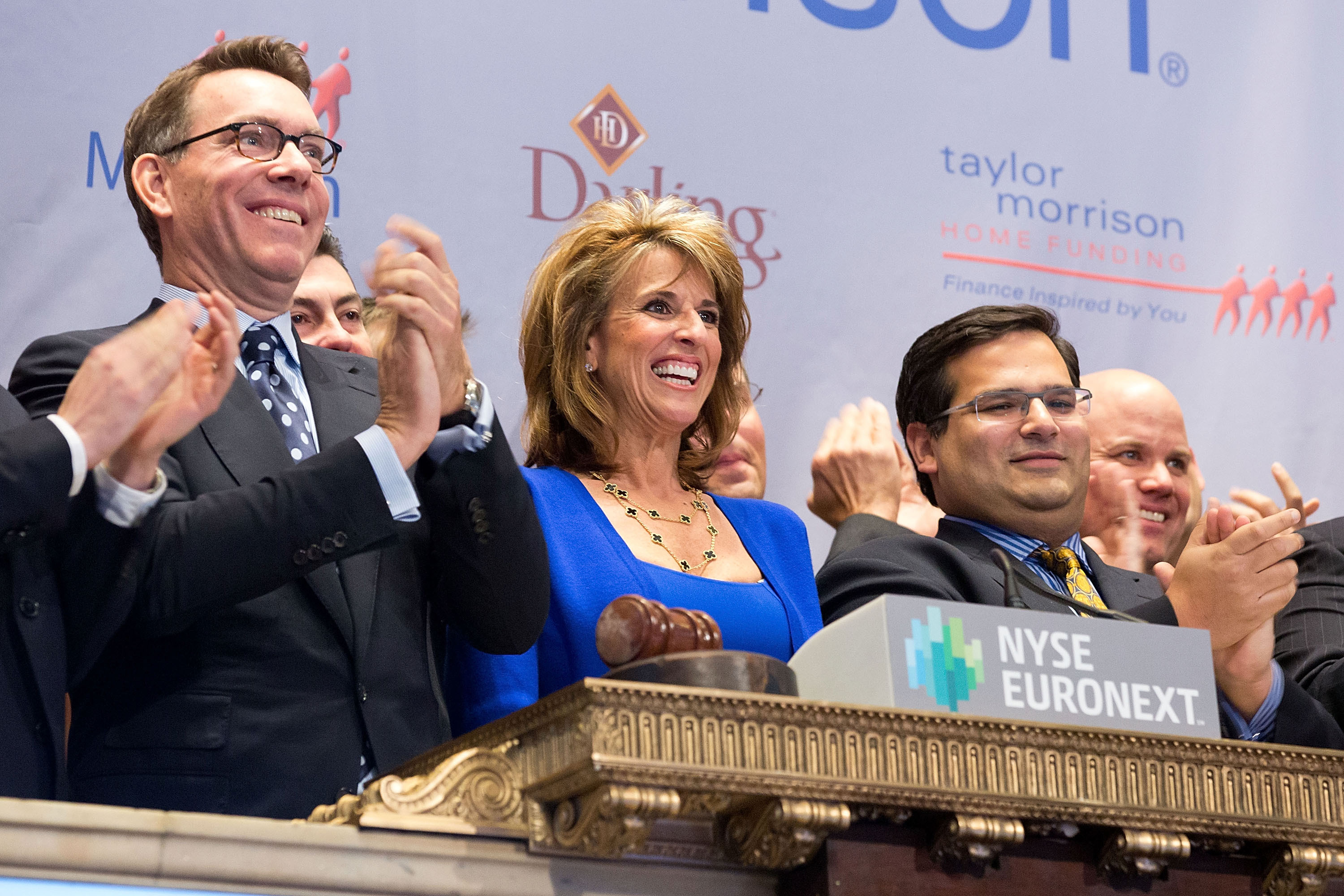 Taylor Morrison President and Chief Executive Officer Sheryl Palmer in the center of the trading crowd as the company's stock opens on the NYSE. (Source: NYSE Euronext photo)