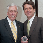 U.S. Rep. Steny Hoyer (D-MD), left, receives Save the Children's Congressional Champion for Real and Lasting Change Award from Mark Shriver, senior vice president for Strategic Initiatives at Save the Children. (Photo: Business Wire)