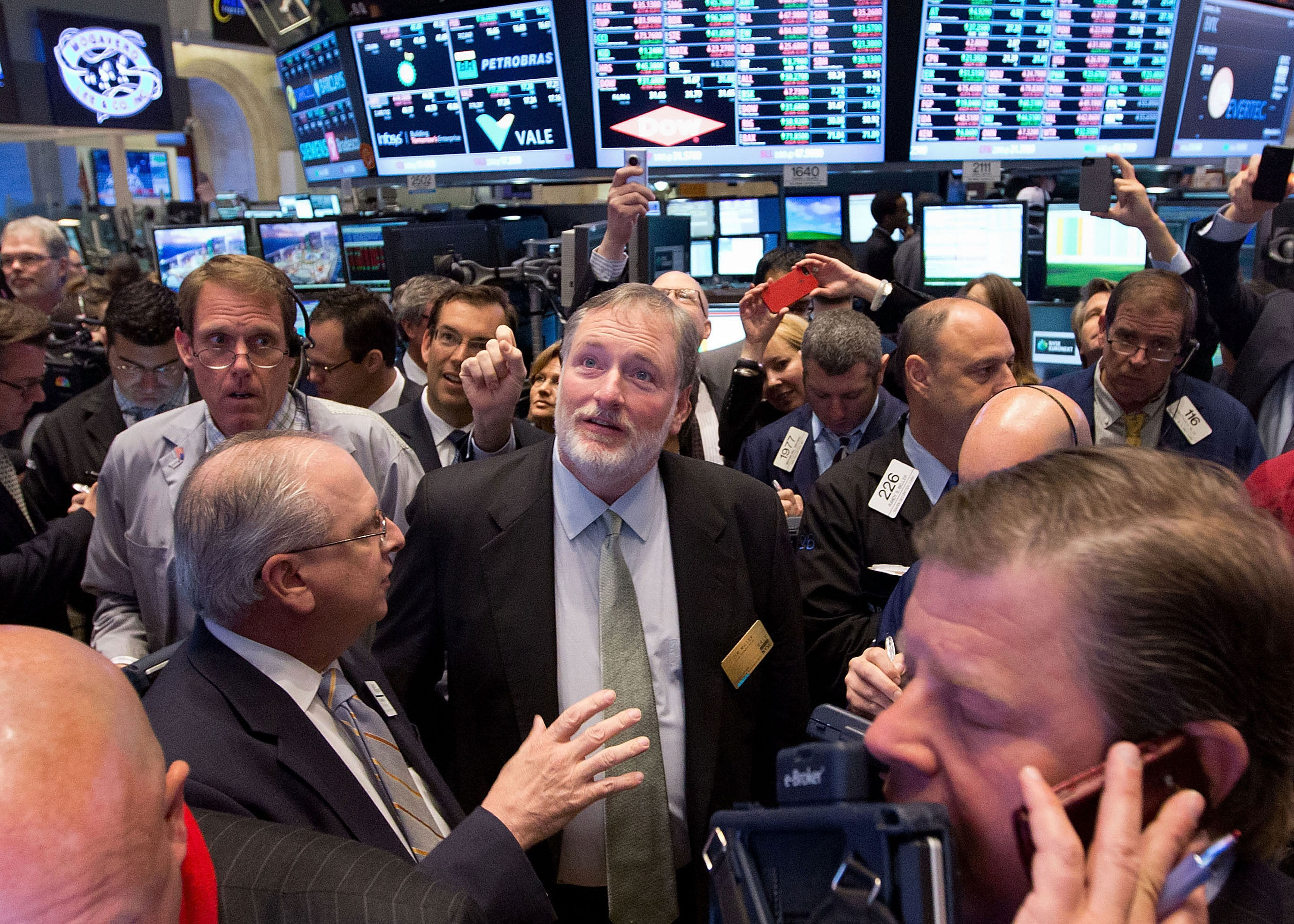 Rally Software Chief Executive Officer Tim Miller in the center of the trading crowd as the company's stock opens on the NYSE. (Source: NYSE Euronext Photo)
