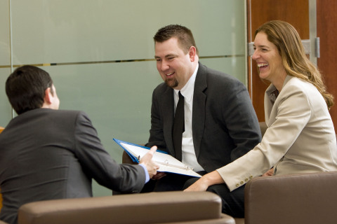 Schwab employees Chris Milton, Eric Curtis and Melissa Steck hold an impromptu meeting in Denver off ...