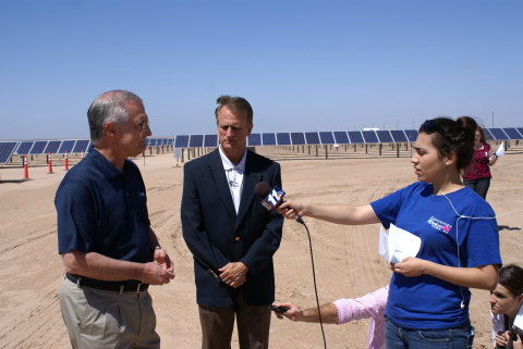 APS Chairman and CEO Don Brandt (far left) and Arizona Corporation Commissioner Gary Pierce (center) conduct interviews with local media following the completion of the first 17 megawatts (MW) of the Foothills Solar Power Plant -- the fifth APS AZ Sun facility. Resting on 400 acres in Yuma County, Foothills is the first solar facility ever to be built on Arizona State Trust Land. By the end of this year, APS will have almost 700 MW of solar energy in its generation portfolio -- enough electricity to serve 175,000 Arizona homes. (Photo: Business Wire)