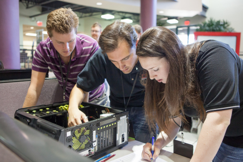 Arizona State University students compete to build a computer using refurbished parts in the 2013 Avnet Tech Games. (L to R) John Read, Chase Foster, Tiffany Shaw (Photo: Business Wire)