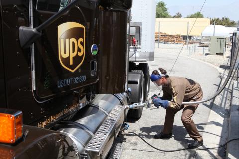 UPS driver, Joseph McGinn, fuels a liquefied natural gas (LNG) vehicle.  Company announced plans to  ...