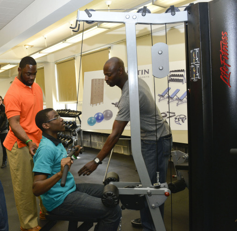 NY Giants' Justin Tuck and NY Mets' LaTroy Hawkins offer students workout tips in the new fitness studio donated by Westin Hotels and Life Fitness at A.C.E. High School in Brooklyn, NY (Photo: Business Wire)