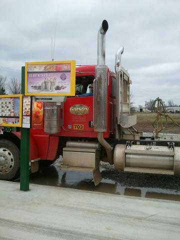 """A truck driver passing through Valliant, Okla., stops at SONIC Drive-In to order lunch from the first drive-in stall built specifically for semi-trucks, trailers, motor homes and buses. Designed by local owners, Tommy and Julie Dorries, the stall's menu and iconic """"Press to Order"""" red button are elevated three feet higher than standard stalls so drivers can easily order without stepping out of their vehicles. (Photo: Business Wire)"""