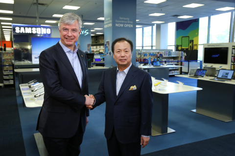 Hubert Joly, CEO of Best Buy, and JK Shin, CEO and President of IT and Mobile Business at Samsung, officially opened the Samsung Experience Shops in the Best Buy Union Square store. (Photo: Business Wire)