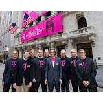 The executive management team of T-Mobile US, Inc., led by President and CEO John Legere (center, front) and CFO J. Braxton Carter (center, rear), gathers outside the New York Stock Exchange on May 1, 2013 in New York City before ringing the Opening Bell to commemorate the company's listing. (Photo by Ben Hider/NYSE Euronext)