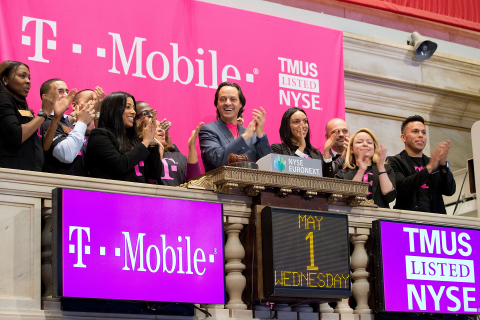 John Legere, President and CEO of T-Mobile US, Inc., (center) and employees of the combined company ...