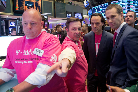 John Legere, President and CEO of T-Mobile US, Inc., and Scott Cutler of the New York Stock Exchange watch from the floor as T-Mobile US, Inc. begins trading following the successful completion of its combination with MetroPCS on May 1, 2013. (Photo by Ben Hider/NYSE Euronext)