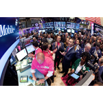 John Legere, President and CEO of T-Mobile US, Inc., (center) gathers with traders on the floor of the New York Stock Exchange as T-Mobile US, Inc. begins trading following the successful completion of its combination with MetroPCS on May 1, 2013. (Photo by Ben Hider/NYSE Euronext)