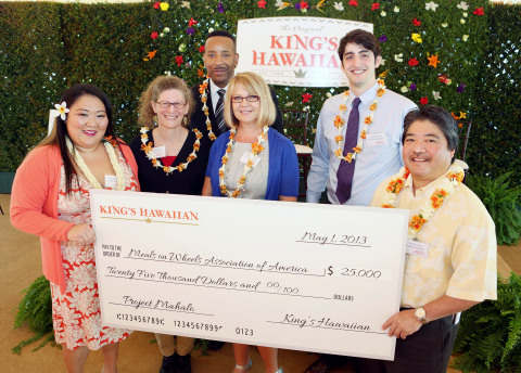 King's Hawaiian CEO Mark Taira and his daughter Courtney Taira present Project Mahalo donations to representatives of Big Brothers Big Sisters of America, Family Caregiver Alliance, Meals On Wheels Association of America and One Warm Coat at the King's Hawaiian headquarters on May 1, 2013, in Torrance, California. Project Mahalo is a King's Hawaiian charitable initiative which honors the contributions made in communities throughout the United States by these four charitable organizations. The event was held on the traditional Hawaiian holiday of Lei Day. (Photo: Business Wire)