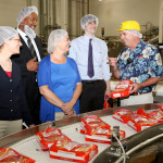 King's Hawaiian provided a private tour of their bakery and presented Project Mahalo donations to representatives of Big Brothers Big Sisters of America, Family Caregiver Alliance, Meals On Wheels Association of America and One Warm Coat at the King's Hawaiian headquarters on May 1, 2013, in Torrance, California. Project Mahalo is a King's Hawaiian charitable initiative which honors the contributions made in communities throughout the United States by these four charitable organizations. The event was held on the traditional Hawaiian holiday of Lei Day. (Photo: Business Wire)