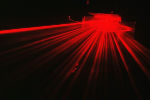 This image shows light scattering from a thin fiber particle illuminated by a laser beam. In this ca ...
