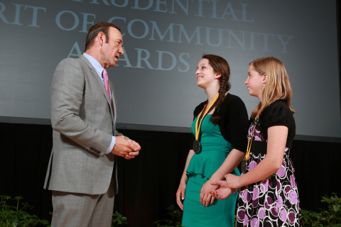 Academy Award-winning actor Kevin Spacey congratulates Alison Forger, 17, of Monroe (center) and Anna Murphy, 11, of Stafford Springs (right) on being named Connecticut's top two youth volunteers for 2013 by The Prudential Spirit of Community Awards. Alison and Anna were honored at a ceremony on Sunday, May 5 at the Smithsonian's National Museum of Natural History, where they each received a $1,000 award. (Photo: Business Wire)