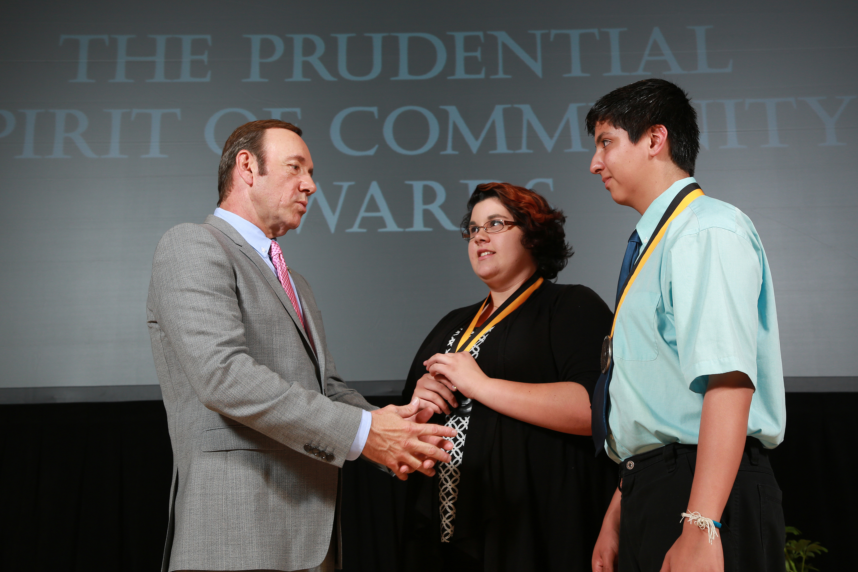 Academy Award-winning actor Kevin Spacey congratulates Brianna Swinderman, 16, of Rio Rancho (center) and Joseph Lee Estrada, 14, of Velarde (right) on being named New Mexico's top two youth volunteers for 2013 by The Prudential Spirit of Community Awards. Brianna and Joseph were honored at a ceremony on Sunday, May 5 at the Smithsonian's National Museum of Natural History, where they each received a $1,000 award. (Photo: Business Wire)