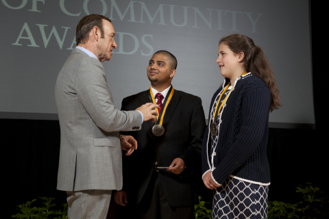 Academy Award-winning actor Kevin Spacey congratulates Neel Desai, 18 (center) and Michaela Forgione ...