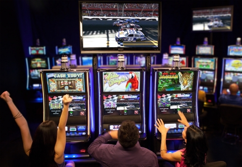 Bally Technologies' Virtual Racing(TM) NASCAR(R) will power an attempt for a GUINNESS WORLD RECORDS(R) achievement at Mohegan Sun in Uncasville, Conn., May 11 at 5 p.m. (Photo: Business Wire)