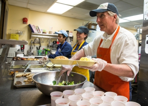 Cardinal Bank President Kevin Reynolds serves breakfast to Miriam's Kitchen's guests. (Photo: David Galen, Galen Photography)
