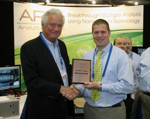 Elie Braun, Director of Business Development, APIX USA, accepts award from Dr. Bob Stevenson, Editor ...