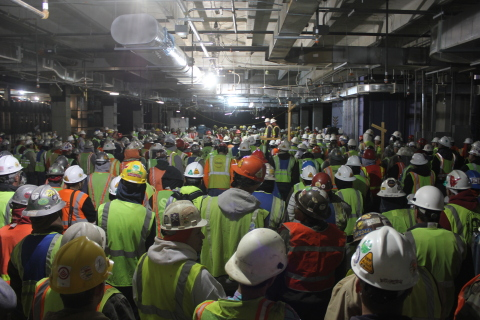 """Construction workers gather in an office building at the new ExxonMobil Houston campus for a weekly """"all hands"""" meeting to discuss site safety. (Photo: Business Wire)"""