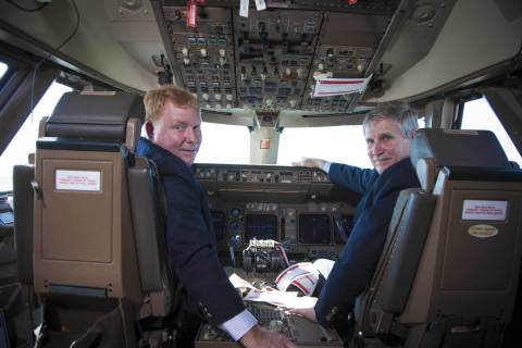 "William ""Billy"" Moore, president MidairUSA, and Richard A. Ennis, executive director Melbourne International Airport, sit in the cockpit of a Transaero Airlines Boeing 747-400 currently undergoing modifications at the airport (Photo: Business Wire)"