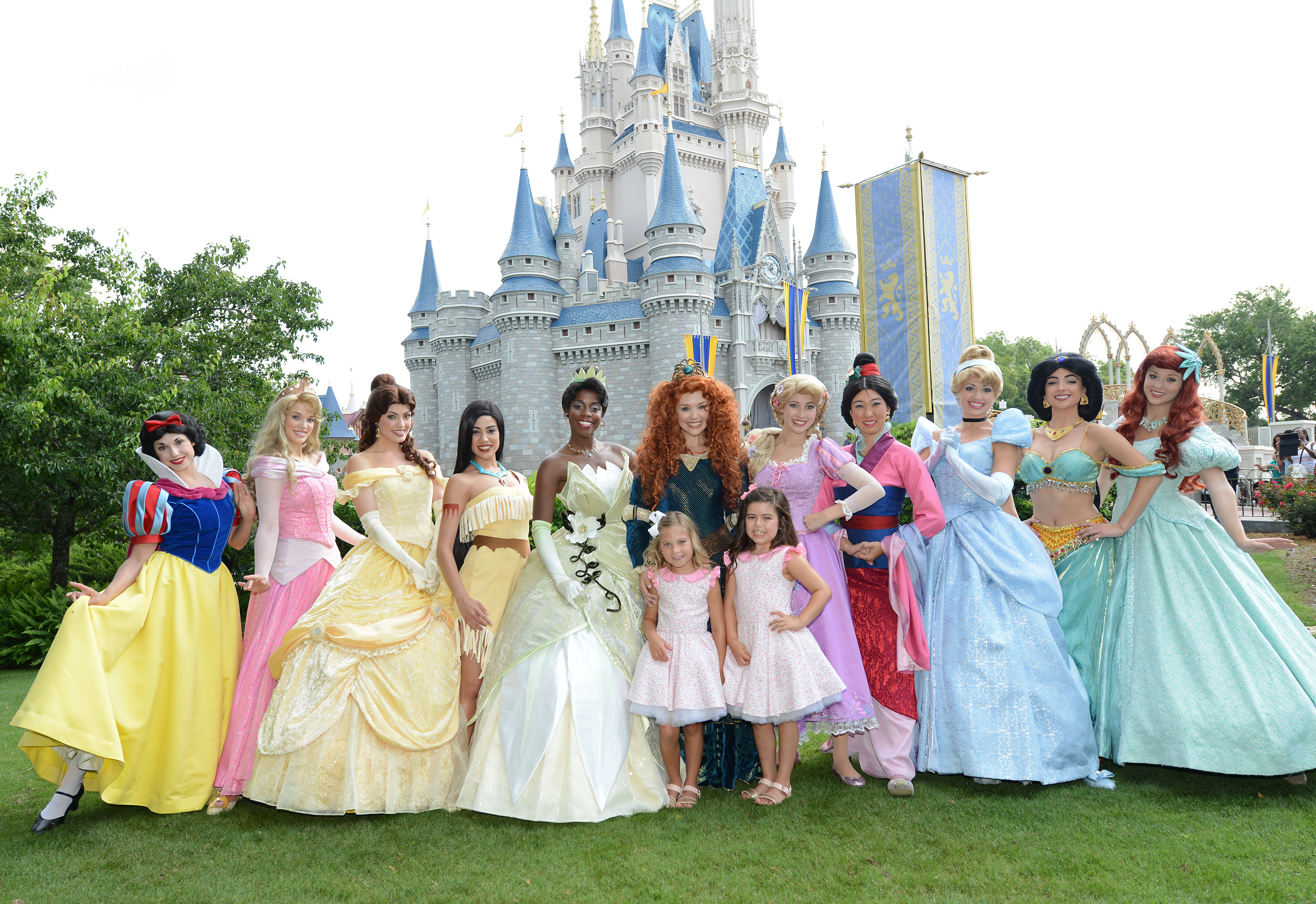 """Rosie McClelland (front left) and Sophia Grace Brownlee (front right), TV personalities from """"The Ellen DeGeneres Show,"""" pose with the newest Disney Princess, the brave and passionate Merida, and the rest of the Disney Princess royal court at Magic Kingdom in Lake Buena Vista, Fla. (Photo: Business Wire)"""