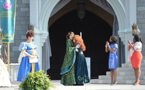 "Gymnastics gold medalist Gabby Douglas and her mother Natalie Hawkins look on as the heroine from the Disney-Pixar animated film ""Brave"" is crowned a Disney Princess by her mother Queen Elinor on May 11, 2013 in conjunction with Mother's Day festivities at Walt Disney World Resort in Lake Buena Vista, Fla. (Photo: Business Wire)"