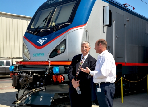Joe Boardman, Amtrak president & CEO, and Michael Cahill, president of Siemens Rail Systems division in the U.S., with one of the new advanced technology locomotives that will improve reliability, efficiency and mobility in the Northeast. (Photo: Business Wire)