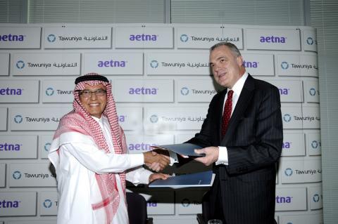 Photograph of Mark Bertolini and Tawuniya's CEO Ali Subaihin taken after the contract signing. (Phot ...