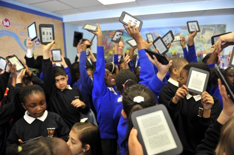 Children from St Mary's Catholic Primary School, Battersea holding NOOK® eReaders. NOOK announces that it has partnered with leading UK publishers Hachette UK, HarperCollins, Penguin and Random House to provide free top selling children's books loaded onto the 1,000 NOOKs donated by Barnes & Noble to aid the Get Reading campaign. (Photo: Business Wire)