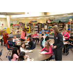 (L-R): Cardinal Bank employees: Ximena Cheatham, Shannon Owens and Barbara Levengood teach students at Terra Centre Elementary School. (Photo: Mattox Photography)