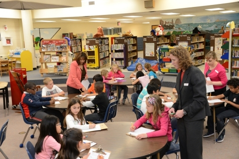 (L-R): Cardinal Bank employees: Ximena Cheatham, Shannon Owens and Barbara Levengood teach students ...