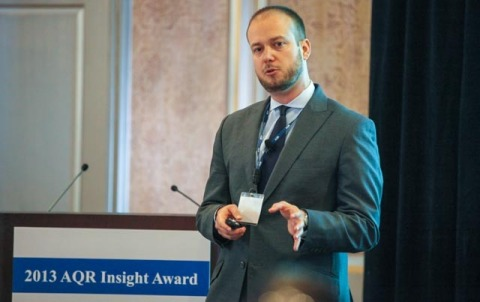 A 2013 AQR Insight Award prize winner, Matteo Maggiori, Ph.D., of the New York University Stern School of Business presents to the AQR Insight Award Committee on April 25, 2013, in Greenwich, Conn. Photo by Robert B. Sweig