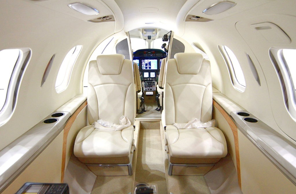 The fifth FAA-conforming HondaJet has a production interior with standard lavatory and options, including a side-facing seat. (Photo: Business Wire)