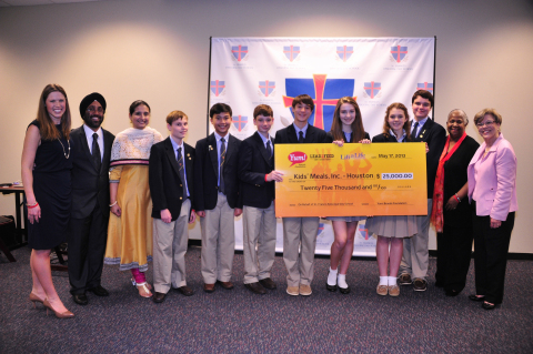 Ashley Butler, Director of Lift a Life Foundation, left, presents the winners from St. Francis Episc ...