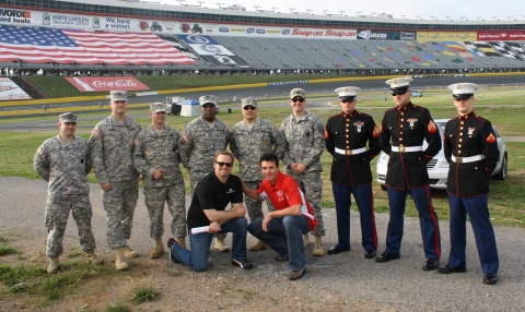 John Schnatter, (front row right) founder, chairman and CEO of Papa John's, and Marcus Smith, president and general manager of Charlotte Motor Speedway, will compete in a drag race as part of a special pizza party celebration for 10,000 troops and family members Sunday at the zMAX Dragway at Charlotte Motor Speedway. (Photo: Business Wire)