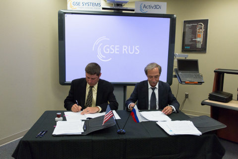 Jim Eberle, CEO of GSE Systems, and Electrobalt General Director Vladimir Arashansky sign agreement ...