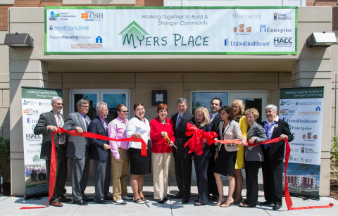 Community leaders, project partners and local residents celebrate the grand opening for Myers Place, ...