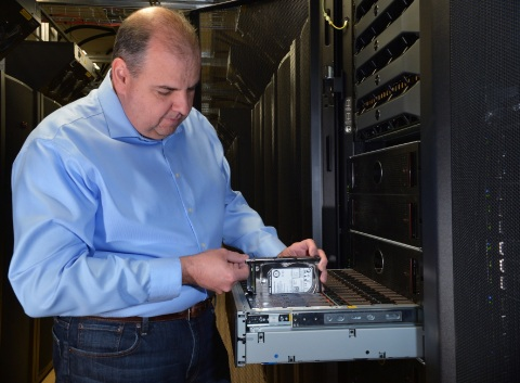 Ed Fiore, vice president of engineering for Dell storage, inspects a new Dell Compellent SC280 super ...