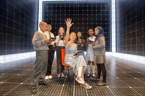 Niamh Cusack, star of The Curious Incident of the Dog in the Night-Time, reads to pupils from St Gabriel's School in Westminster on NOOK® devices at the Apollo Theatre in London. NOOK and the Evening Standard today announced that the Get Reading free festival, which will take place in the iconic Trafalgar Square on Saturday 13th July, will feature Rupert Everett, the cast of Billy Elliot The Musical, a reading from The Curious Incident of the Dog in the Night-Time, and 'Joey' from War Horse. (Photo: Business Wire)