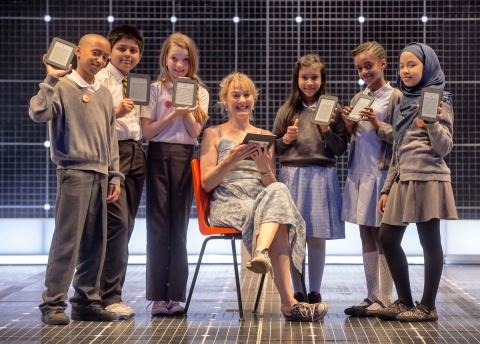 Niamh Cusack, star of The Curious Incident of the Dog in the Night-Time, and pupils from St Gabriel's School in Westminster holding NOOK® eReaders at the Apollo Theatre in London. NOOK and the Evening Standard announced today that the Get Reading free festival in Trafalgar Square on July 13 will feature will feature a reading by Rupert Everett, a performance by the cast of Billy Elliot The Musical, a reading from The Curious Incident of the Dog in the Night-Time, and an appearance by 'Joey' from War Horse. (Photo: Business Wire)
