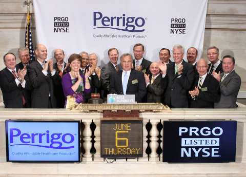 Perrigo Company CEO Joseph C. Papa, joined by members of the company's leadership team, rings the NY ...