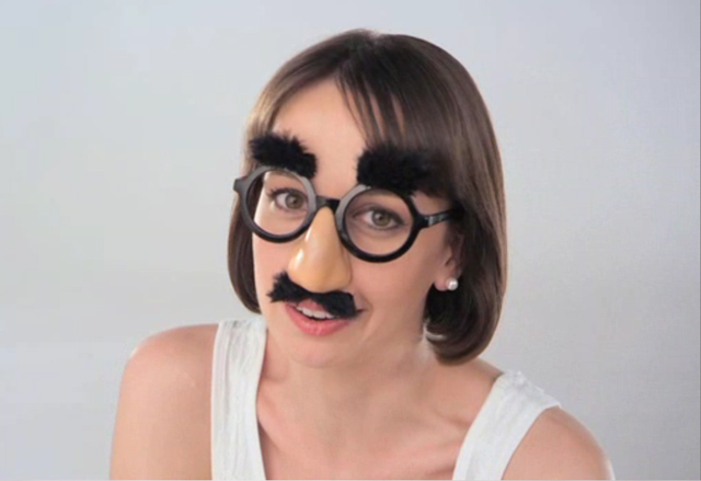 """A woman disguises herself with Groucho glasses and mustache to discuss how vaginal pH imbalance can cause feminine odor. """"It's the perfect parallel for the way deodorizing products try to 'disguise' feminine odor."""" RepHresh Vaginal Gel is clinically shown to eliminate the cause of odor, unbalanced feminine pH, so odor really does go away without the need for added scents or deodorants."""