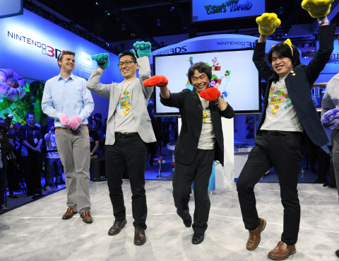 In this photo provided by Nintendo of America, famed video game designer Shigeru Miyamoto and fellow developers, Yoshiaki Koizumi (R) and Koichi Hayashida (second L), playfully demonstrate the cat transformation in Super Mario 3D World during the Wii U Software Showcase @ E3 2013 on June 11, 2013 in Los Angeles. The Electronic Entertainment Expo (E3) is the video game industry's premier trade show. (Photo: Business Wire)
