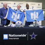 Nationwide Insurance chief marketing officer Matt Jauchius presents Dallas Cowboys owner and general manager Jerry Jones and Pro-Bowler DeMarcus Ware with Nationwide flags during the partnership announcement on June 11 at Valley Ranch. (Photo: Business Wire)