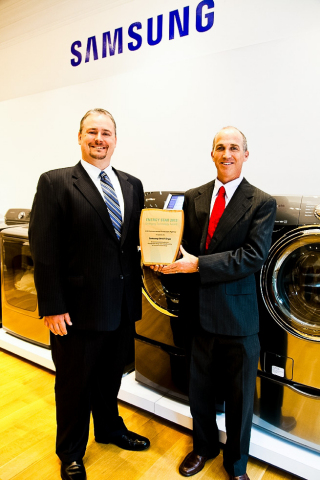EPA's Peter Banwell, Director of Product Marketing, presents Samsung's Dean Brindle, Director of Lau ...