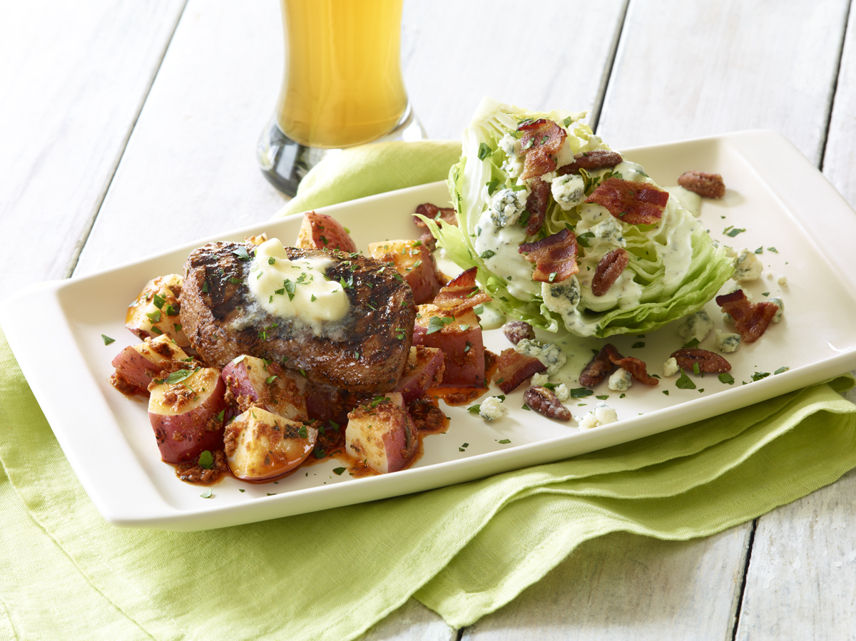 With Applebee's new Take Two, starting at $10.99, guests can sample two Fresh Flavors of Summer menu selections like the Blackened Sirloin and Green Goddess Wedge salad. (Photo: Business Wire)