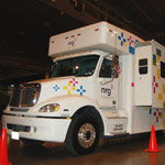 "NRG Energy introduced the ""Power2Serve"" concept, an employee volunteer effort in tandem with a 42-foot disaster relief vehicle and 26-foot trailer combination that delivers electricity through solar panels and diesel generators, emergency shelter and other services to communities in times of disaster. (Photo: Business"